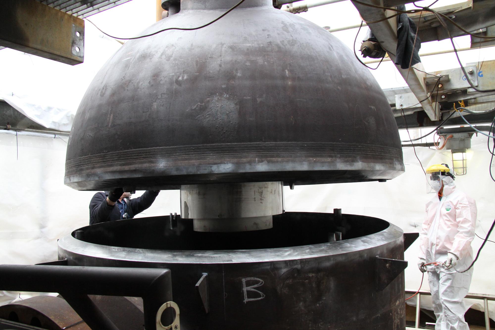 Lowering head onto shell